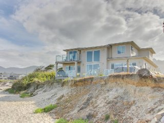 Gaze at the sea with your dog from this oceanfront house w/ easy beach access!