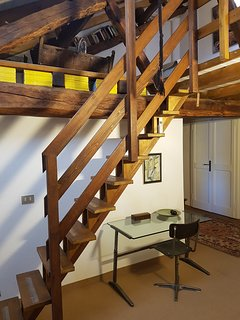 Stairs leading from 2nd floor lounge to loft master bedroom.