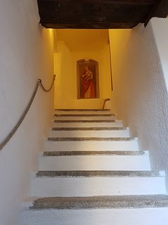 Stairs from mezzanine floor to second floor bedrooms. Original fresco.