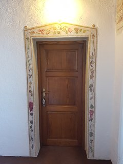 Decoration surrounding the door to the mezzanine bedroom.