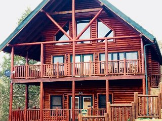 Almost Paradise is a luxurious 4 bedroom cabin.