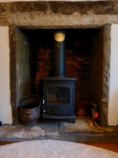The Aga wood burning stove in the lounge is perfect after a cold walk in the hills