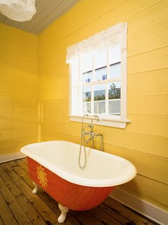 Enjoy a bath in our authentic antique cast iron tub