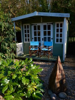 The summerhouse in the rear garden. The perfect place to catch up on work emails, or a glass of wine