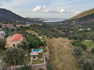 Villa Pathos a comfortable and luxury vacations painted red.