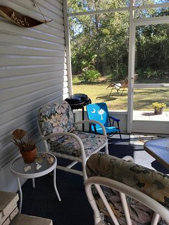 Screened-in Lanai with private backyard (view of palm trees & palmettos)