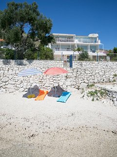 Small beach for our guests in front of the villa
