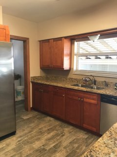 Fully equipped kitchen, utensils, plates, glasses, dishwasher, coffee pot, waffle maker, etc