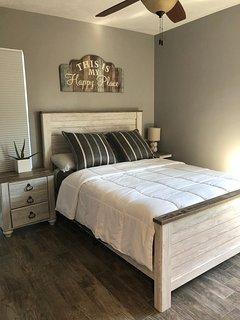 Guest bedroom, queen bed, walk in closet, ceiling fan