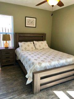 Guest bedroom, queen bed built in workspace, ceiling fan