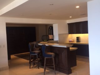 Kitchen with den beyond with full-size murphy bed