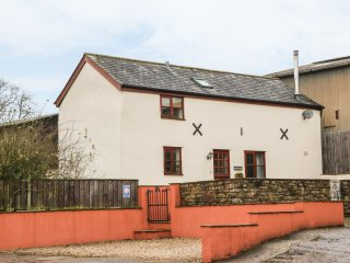 STABLES COTTAGE, feature beams, enclosed garden with furniture, woodburning stov