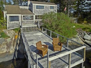 Cottage with deck over the water