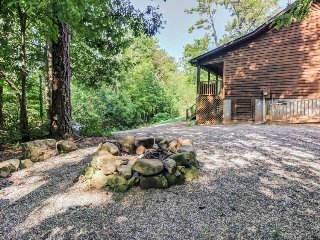 Spacious, dog-friendly cabin with screened-in deck, private hot tub, & firepit