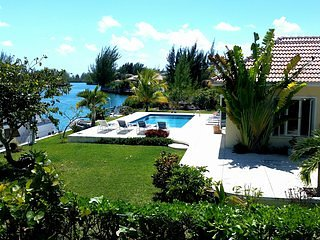 LUXURY WATERFRONT VILLA NEAR BEACH WITH POOL AND SMALL BOAT