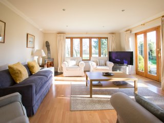 sitting room open plan into kitchen & doors leading into garden