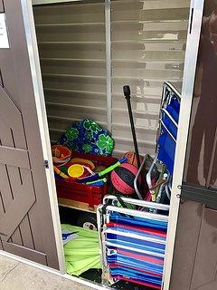Beach cart, beach chairs and toys