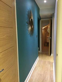 Hallway between lower ground bedrooms .. leads to a bathroom.