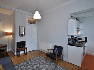 Living room with open plan kitchenette