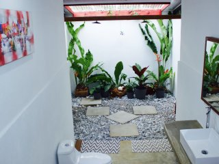 Main bathroom with double shower in an enclosed garden