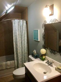 Upstairs full bathroom with Jacuzzi tub.