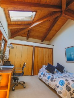 Skylights and cathedral ceilings in third bedroom.