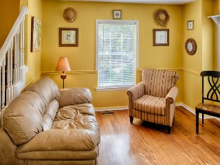 Dog-friendly home with a lovely sundeck & sunroom, close to the beach!