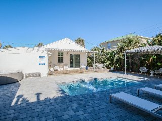 Bright 1940s beach cottage with a private pool and hot tub.