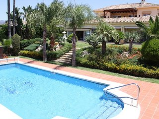 Luxury villa with a wonderful garden and stunning sea and mountain views