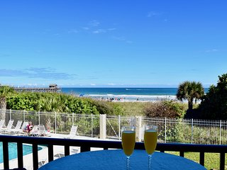 On the beach & steps to the pier. Enjoy beautiful views from your balcony!