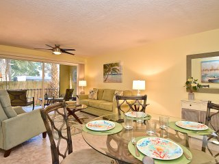 Comfortable and tastefully decorated open concept living space.