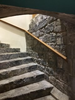 The historic stone steps lead to lower ground modern bedrooms and bathroom