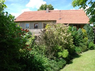 New farmhouse apartment near recreational lake with swimming, ideal for families