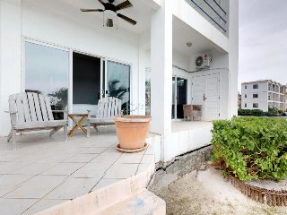Lagoon-front suite w/ pool access, spacious patio, grill, free WiFi, and more