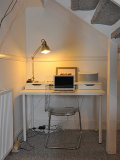 Desk area with house manual, local guide, wifi, speakers
