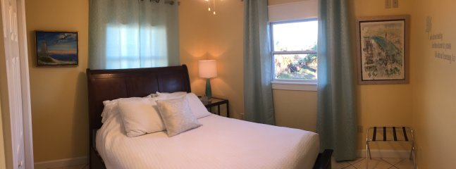 The ocean view guest bedroom has a queen bed and direct access to the bathroom.