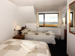 Family room with Double & Single bed, ensuite,  and sea views