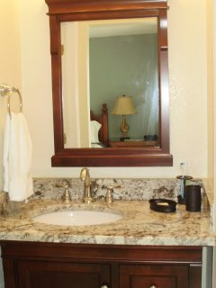 Renovated master bathroom with granite countertop.