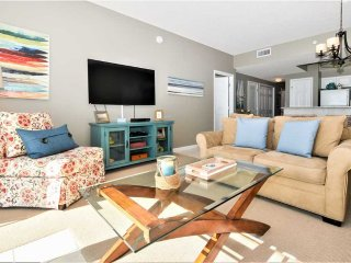 Fresh decor in family room; queen sleeper sofa; 55'smart TV