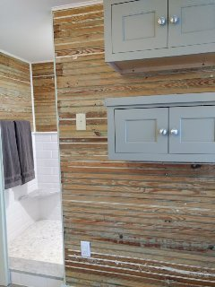 Bathroom has custom touches like cypress bead board