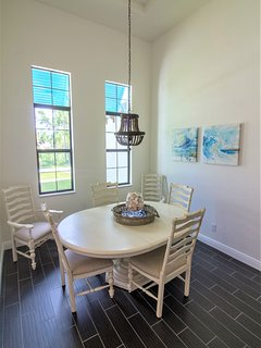 Formal dining with seating for 8, plus you have 4 bar stools and 4 chairs in the breakfast area