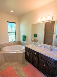 5 piece master bathroom with jetted soaking tub, double vanities and easy walk in shower