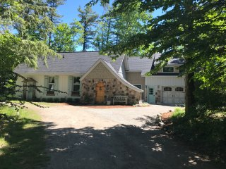 Storybook cottage with 120' of private beach frontage on Grand Traverse Bay!