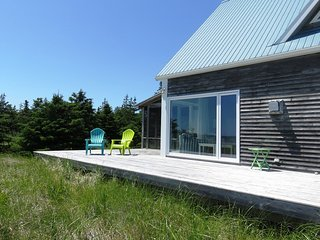 Sit and relax on the deck at Sanderling Beach House