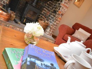 The inglenook fireplace with woodburner