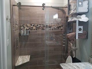 Walk in shower, Caribbean Dunes #124, 1 bdr, Sleeps 6, Full Kitchen, Full W&D.