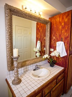 A phenomenal decorative mirror reflects class in this tub and shower combination
