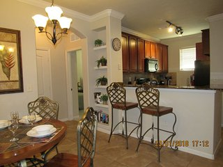 Cozy, fully furnished 4/3 Condo at Bella Piazza. Minutes to shopping, dining