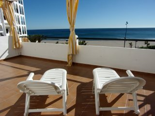 Your Home in the Sun. Beachfront Apartment with Pool, Sea Views and free WIFI.