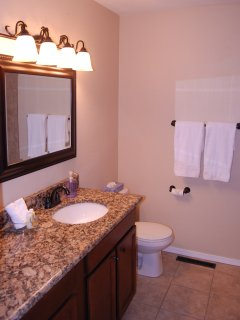Hall bathroom has granite counters, tile and upgraded fixtures